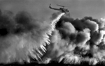 First place photograph in the World Press Photo Foundation's nature category, 2004. A California Department of Forestry helicopter drops water on a fire burning in the Santa Ana River bed in Mira Loma, Calif. (The Press-Enterprise/ Mark Zaleski)