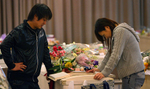 A couple spends time with a family member during a funeral service at the Berko Natori funeral home in Sendai, in the Miyagi Prefecture of northern Japan. (The Press-Enterprise/ Mark Zaleski)