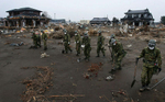 Japan's Ground Self-Defense force members search through debris near the Sendai Airport looking for victims after a 9.0 earthquake and tsunami devastated Sendai in the Miyagi Prefecture of Japan. (The Press-Enterprise/ Mark Zaleski)