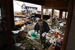 Kimio Sugai, 71, searches through the ruins of his home hoping to find anything he can use after a 9.0 earthquake and tsunami devastated Sendai in the Miyagi Prefecture of northern Japan on March 11, 2011. Kimio and his wife, Katsuko,lost their son, who was firefighter working when the tsunami hit. (The Press-Enterprise/ Mark Zaleski)