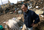 Ichio Hirayama pauses while trying to salvage any personal belongings from his home that was destroyed when the massive tsunami hit Sendai, Japan. (The Press-Enterprise/ Mark Zaleski)