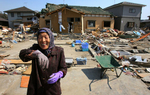 Kiyoe Abe, 80, stops herself from crying then breaks into laughter saying she was glad to have survivedthe massive tsunami that destroyed her home in Shichigahama, a fishing town of northern Sendai, Japan. (The Press-Enterprise/ Mark Zaleski)