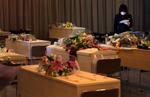 A Berko Natori funeral home assistant checks the funeral schedule sheet listing victims of the massive earthquake and tsunami that hit Sendai, in the Miyagi Prefecture of northern Japan. (The Press-Enterprise/ Mark Zaleski)