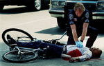 A San Bernardino police officer Mike Wilson attempts to revive a shooting victim near Waterman Avenuein San Bernardino, Calif. The city was ranked No. 1 in the nation for homicides in the early 1990s. (The San Bernardino Sun/ Mark Zaleski)