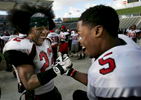 Corona, Calif., Centennial's Jerry Hardeman, left, and Marsel Posey celebrate on the bench before the end of the game. Corona Centennial beat Corona Santiago 42-7 to win the CIF Southern Section Inland Division Championship at the Home Depot Center in Carson Calif. (The Press-Enterprise/ Mark Zaleski)