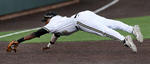 Vanderbilt third baseman Xavier Turner dives to stop a ground ball for an out against Georgia Tech in the fourth inning of a 2013 NCAA college baseball tournament regional game in Nashville, Tenn.(AP Photo/Mark Zaleski)