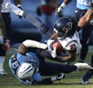 Houston Texans wide receiver DeAndre Hopkinsis brought down by Tennessee Titans linebacker Moise Fokou in the fourth quarter of an NFL football game on Dec. 29, 2013, in Nashville, Tenn. (AP Photo/ Mark Zaleski)
