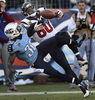 Tennessee Titans cornerback Jason McCourty breaksup a pass intended for Houston Texans wide receiver Andre Johnson in the fourth quarter of an NFL football game on Dec. 29, 2013, in Nashville, Tenn. (AP Photo/Mark Zaleski)