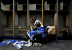 UCLA's Darren Collison sits alone in the locker room after losing to the University of Memphis during the 2008 NCAA Division I Men's Final Four at theAlamodome in San Antonio, Texas. Memphis beat UCLA 78-63. (The Press-Enterprise/ Mark Zaleski)
