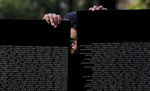 Marcos Ramirez, 67, of Loma Linda, Calif., holds up two panels of the Vietnam Veterans Memorial Moving Wall during its construction for a temporary exhibit in Redlands, Calif. (The Press-Enterprise/ Mark Zaleski)