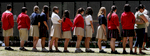 Students from Sacred Heart Academy in Redlands, Calif., walk by the The Moving Wall looking at the names of the fallen soldiers during a class outing.(The Press-Enterprise/ Mark Zaleski)