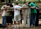 Veterans from the Loma Linda Veterans Hospital embrace while they say a prayer after visiting the Vietnam Veterans MemorialMoving Wall at Sylvan Park in Redlands, Calif. (The Press-Enterprise/ Mark Zaleski)