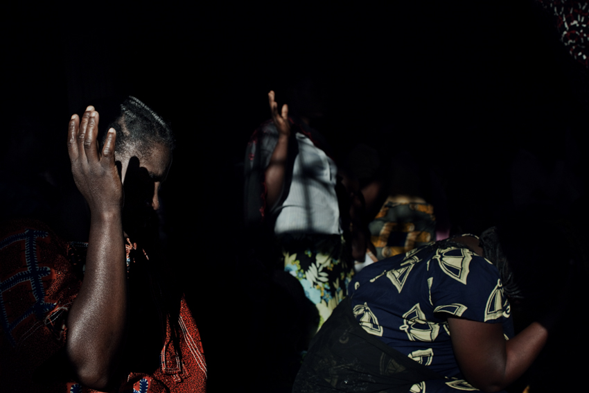 Africa, Democratic Republic of Congo; South Kivu; Bukavu. 03/02/2009. Some women are praying during the Mass of the sect called {quote}the Seventh Era{quote}.