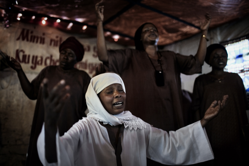 Africa, Democratic Republic of Congo; South Kivu; Bukavu. 05/02/2009. Believers attended to a Mass service in a {quote}Revival Church{quote}. During these Masses, believers are caught by hysteria and exorcisms are common.