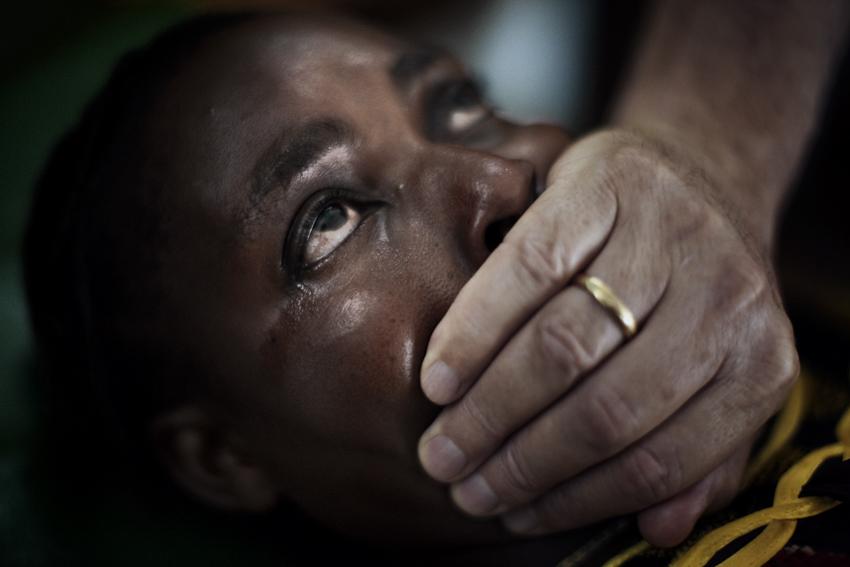 Africa, Democratic Republic of Congo; South Kivu; Bukavu. 22/01/2009. An exorcism ritual conducted by the Catholic priest father Nardo Riccardo.