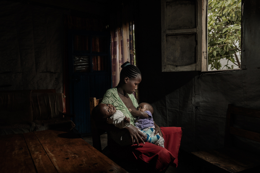 Africa, Democratic Republic of Congo, North Kivu, Goma. 24/01/2017. O. L. ,  13, was raped by a member of the parish, and was left pregnant as a result. On 19 August, she gave birth to twins. Today she lives with her mother and a close female relative, who help her with the children, but she has been stigmatised and isolated by the community. The Italian NGO AVSI is providing her with social and medical support, and is also helping her with school.