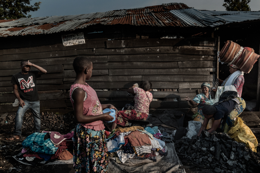 Africa, Democratic Republic of Congo, North Kivu, Goma. 25/01/2017. A daily life scene in one of the markets of Goma. Women sell clothes and coal on the road. Women are a driver for Congolese society, because it is the women who perform the most varied tasks in order to support their families, and they are also responsible for raising children. More often than not, rape goes unpunished in the Congo. Rape victims totalled 15,000 in 2015 alone.