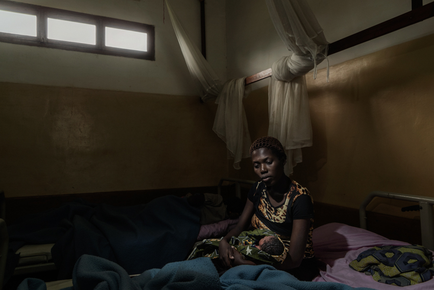 Africa, Democratic Republic of Congo, North Kivu, Rutshuru, 27/01/2017. Bora Uzima Safari, 18, displaced during the M23 war in 2012, left Rutshuru and took refuge with her mother and siblings in Mweso. On april 2016, on her way back from school, she was raped in the fields by two men with their faces covered. When she discovered she was pregnant, she was abandoned by her boyfriend and all her friends. For the whole of her pregnancy, she suffered an untreated vaginal infection that has made it difficult for her to walk. On 27 January, she gave birth to her daughter Giselle, conceived when she was raped. Her mother was also raped in Mweso.