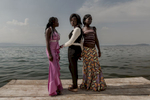 Africa, Democratic Republic of Congo, South Kivu, Bukavu. 03/02/2017. Girls poses for a picture on the shores of the Kivu Lake during a party. In the Congo, some 15,000 women are raped every year. One of the most serious repercussions this has – in addition to the physical trauma these women suffer – is the fact that they are then abandoned and confined to the margins of their community, or indeed of their own families.