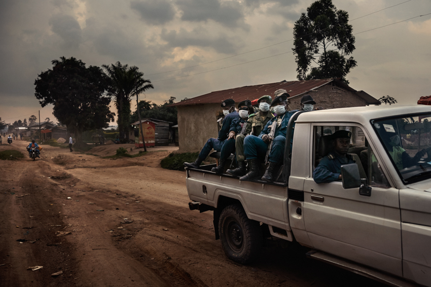 Africa, Democratic Republic of the Congo, North Kivu; Beni. 25th July 2019. The funeral of 13-year-old Kavira Esperance was conducted under army protection to prevent members of the local community attacking the healthcare operators and accusing them of bringing the disease to the village.The girl caught the disease in a local healthcare facility, where she went for treatment for malaria. After testing positive for Ebola, she was taken to the treatment centre, where despite the medical team's efforts, she died three days later.
