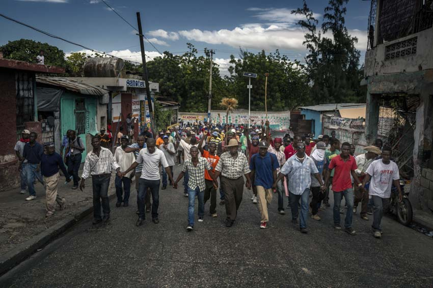 America, Haiti, Port-au- Prince. Thousands of people in the streets during a demonstration against the government. Life in the country remains critical, and the people are crying out for stability and recovery. 25th november 2014©Marco Gualazzini