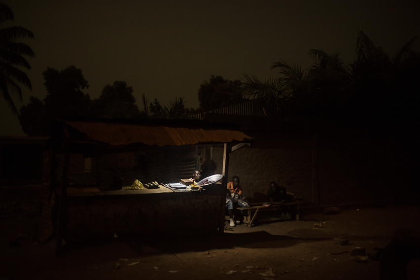 Africa, Central African Republic, Bangui. One of the few businesses that dares stay open in the evenings in the Cocoro neighbourhood, contended by the Anti- Balaka and Ex-Seleka groups. 2nd February 2015©Marco Gualazzini