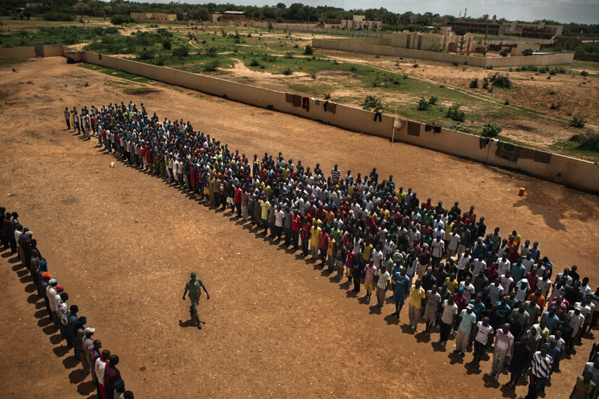 "Africa, Mali, Mopti. 31/07/2012. New Recruits of the Militia Ganda Koy ""Lords of the Land"". The movement was formed over 1994- 1995 and its the oldest militia of Mali. Hundreds of new recruits prepare to train at a militia camp near Mopti."