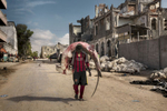 Africa, Somalia, Mogadishu. 10/10/2015. A man carries a shark through the streets of Mogadishu. A recent escalation of plunders of Somali waters by foreign fishing vessels could mean the return of hijackings, locals warn.The country's waters have been exploited by illegal fisheries and the economic infrastructure that once provided jobs has been ravaged.