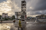 Africa, Somalia, Mogadishu. 19/10/2015. A glimpse of the city: The destroyed structures of the old parliament in the Hamar Weyne district. The present of the Somali capital. Behind it, a civil war lasting 25 years; ahead of it, a future of rebirth. Mogadishu is at a crossroads. On the one side, the persistence of a surreptitious conflict based on a new, asymmetrical strategy of terror with Al-Shabaab, yet on the other, a desire for a return to normal life on the part of the Somali people, who are timidly seeking to carve out a role for themselves.