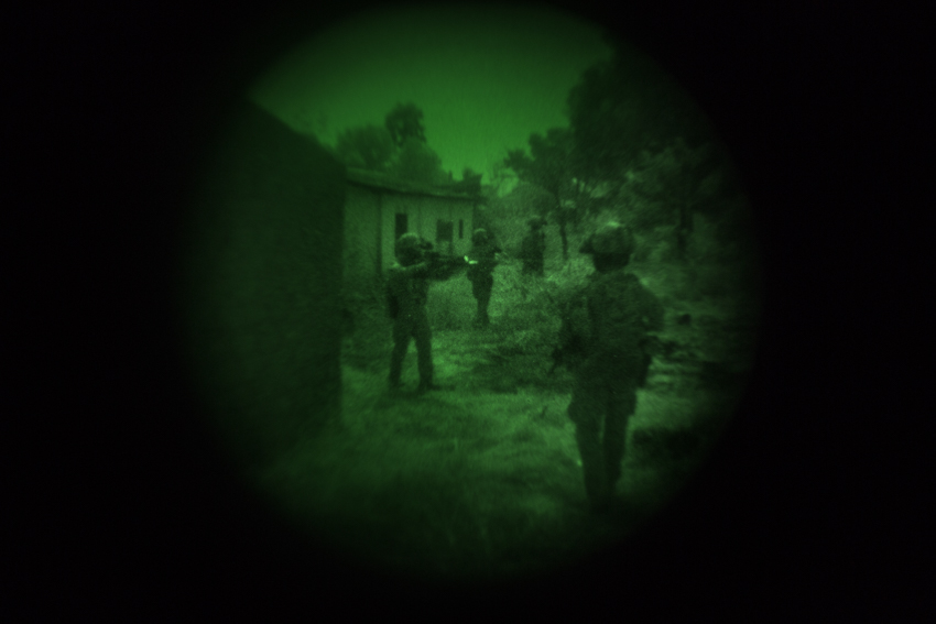 """Africa, Central African Republic, Bangui. The """"3° de Lampurdan"""" special operations group of the Spanish army, part of the EUFOR RCA mission, carrying out night patrol in the Cocoro neighbourhood, where looters and rebel groups hide among the ruins. The photo was taken with a night vision lens during reconnaissance. 2nd February 2015©Marco Gualazzini"""