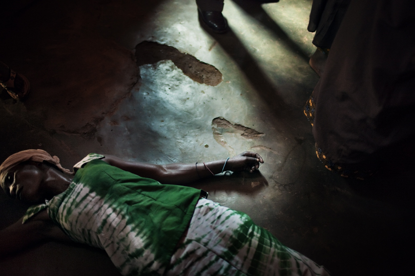 The Democratic Republic of the Congo, South Kivu, Bukavu. 27th February 2009.  A demon-possessed woman fell through the floor during the mass service in a {quote}Revival Church{quote} of Bukavu. Travelling across a country tormented and perennially on the brink of disintegration, this news report tells of the events which fit somewhere between religion and superstition. It investigates the relationship between reality and the escape from it through the unconscious, faith, and the negation of the self. Through the delirious apologia of the Revival Churches, the mysteries unveiled by the sects, by the wafumo sorcerers or the wailing children accused of witchcraft, to arrive at the most expressive fringes of Catholicism.