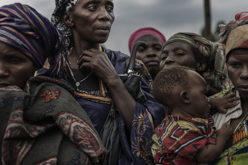 """Africa, Democratic Republic of Congo, North Kivu, Goma. 29/01/2017. A group of vulnerable women who live in what remains of the tent city of Mugunga 3. Every month, the association of Congolese Muslim women """"AFAC"""", made up of women in a situation of extreme poverty themselves, brings them staple food supplies, as well as providing material and psychological support to the women in the camp that have suffered sexual violence and subsequently been abandoned."""