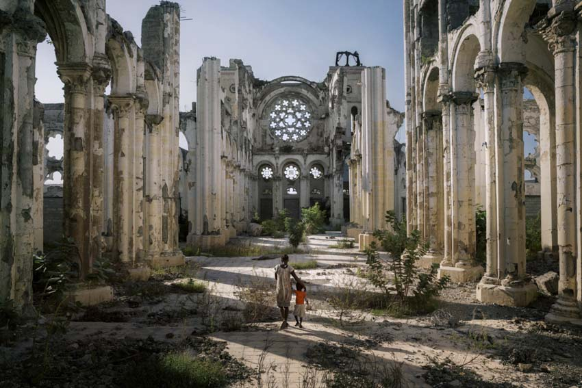 America, Haiti, Port-au- Prince. In the centre of Port Au Prince, the remains of the cathedral destroyed by the earthquake stand out against the skyline. No restoration work is contemplated; these ruins are to remain as a silent witness to the tragedy. 28th November 2014©Marco Gualazzini