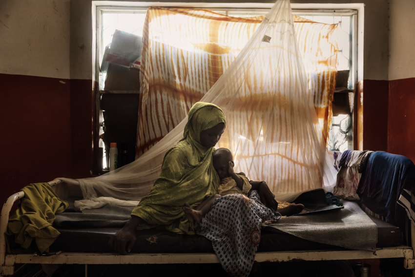 Africa, Somalia, Benaadir region. Mogadishu. 23/09/2017. Faduma Ibrahim Abdi, seen with her baby of 17 months. They are from Jannale- Lower Shabelle. She was forced to flee because of the severe drought that affected Somalia and came to Mogadishu looking for help. Her baby suffers from severe malnutrition.  As of February 2017 a drought ravages Somalia has left more than 6 million people, or half the country's population, facing food shortages with several water supplies becoming undrinkable due to the possibility of infection. According to the Humanitarian Information Unit of the U.S. Government, over 2.9 million people in Somalia face crisis or emergency level acute food insecurity and need emergency food aid.  An estimated 1.1 million IDPs currently live in Somalia, and at least 548,000 additional people have been displaced since November 2016 due to the drought. Most people displaced by drought left rural parts and settled in urban areas such as Mogadishu. Displacement numbers continue to rise. Somalia remains one of the most dangerous place in whole world.
