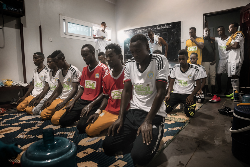 Africa, Somalia, Benaadir region. Mogadishu. 18/09/2017 Elman FC football club. The players are seen in the locker room while praying and getting ready, a few minutes before the match at the Banadir Stadium, located in the Jamacadaha area in Hodan district. Elman Ali Ahmed was a Somali entrepreneur and social activist, assassinated in 1996 near the family's home in the southern part of the city. Ahmed also managed Elman FC, a football team in the city, provided relief services to disadvantaged children, and contributed to rehabilitating community facilities such as roads and electricity. Today Elman FC enjoys a successful record, and closely rivals Banaadir Telecom FC.