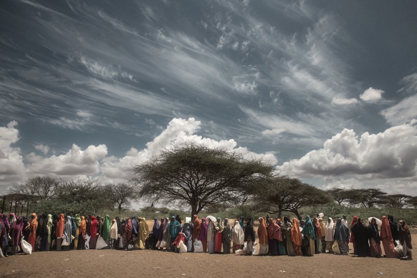 Africa, Kenya, Dadaab. 01/03/2016. Dadaab remains the largest refugee camp in the world, with more than 350,000 inhabitants, 95% of them from Somalia. Located in a semi-arid region of Kenya, 80 km from the Somali border, the camp arose in the Nineties to contain the displaced fleeing from the civil war in Somalia, and has continued to expand since then. Today it is composed of 5 large tent cities spread over more than 50 km. The first week of every month, for five days, food is distributed in Dadaab. All 350,000 refugees report to the distribution points where the WFP distributes food rations. For each member, families are given a monthly ration of 3.5kg of corn, 3kg of flour, 1.8kg of pulses, 1.85lt of oil, 1kg of CSB (Corn-Soya Blend) and 150g of salt.