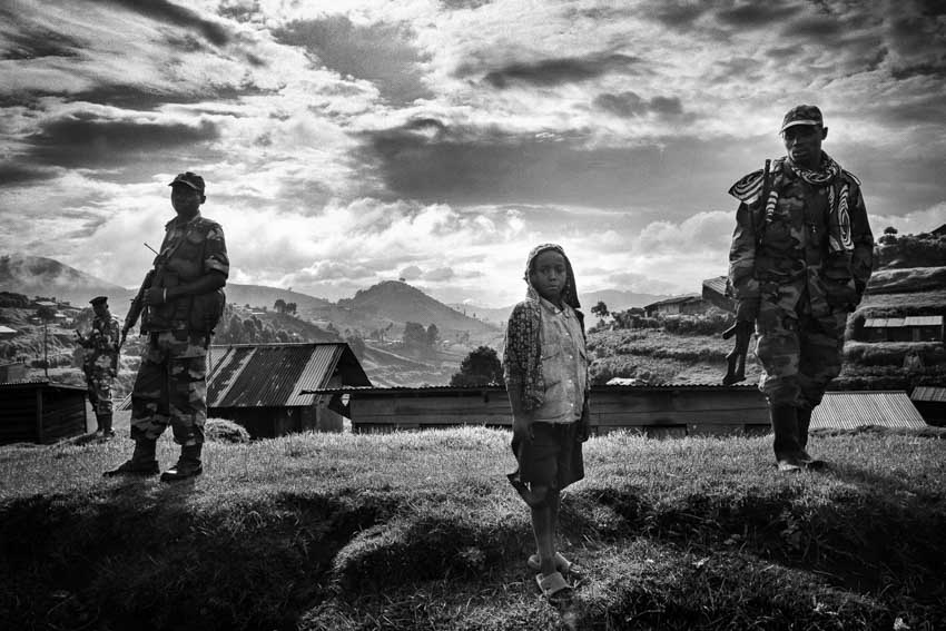 Africa, R.D.C.- North Kivu, Goma. M23 rebel soldier patrols Karuba the last village before the frontline with government troops. The next day M23 leaders ordered a complete withdrawal of all military units to 15km north of Goma. 28th November 2012©Marco Gualazzini/Getty Images Grants for Editorial Photography Recipient 2013.
