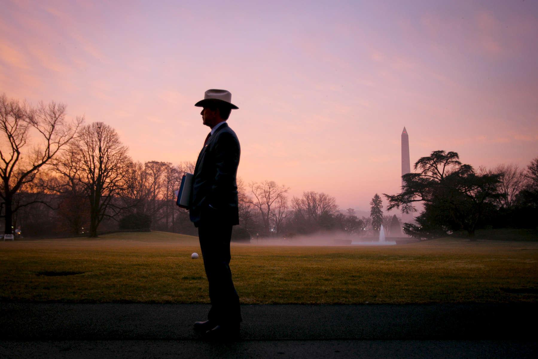 President Bush en route to the Oval Office. South Lawn. Sunrise. Cowboy hat.Bush Family Scrapbook