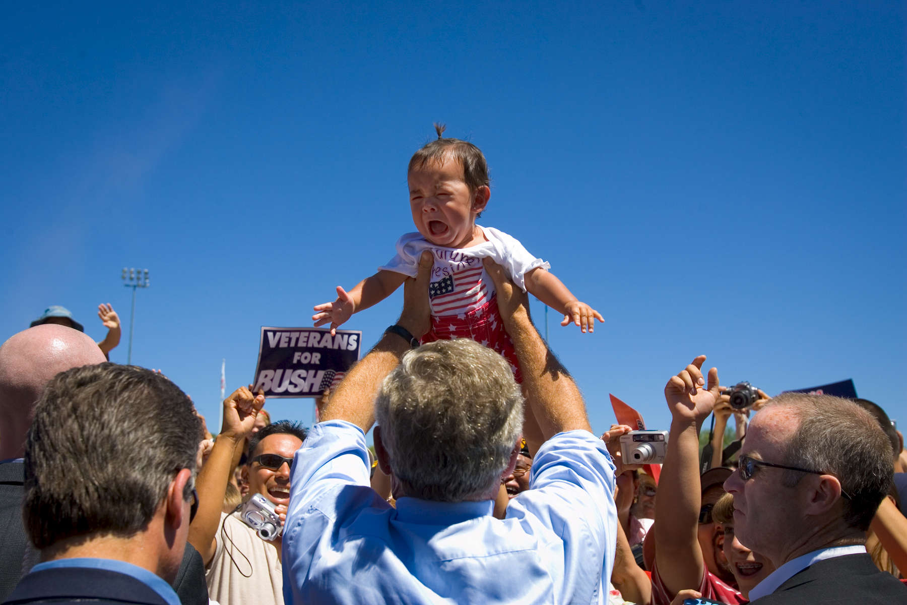 Digital: 12:30 GWB  President Bush: Remarks at Farmington, New Mexico Rally. Ricketts Park. Political. Restricted The President holds a baby.
