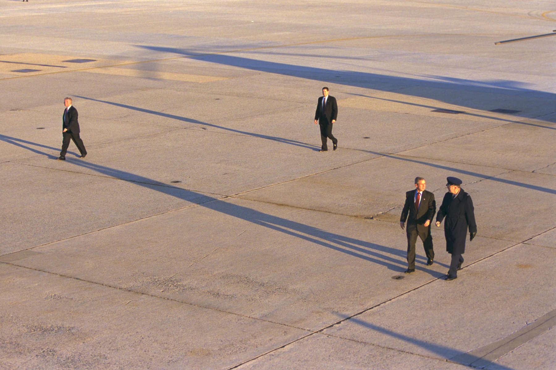 0800, President Bush is escorted from Marine One to Air Force One at Andrews Air Force Base. He departs for Springfield Missouri.