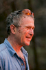 President Bush: Brush clearing and burning with staff. Ranch, Crawford, Texas. View of fire. Fire reflected in the President's protective glasses. POW