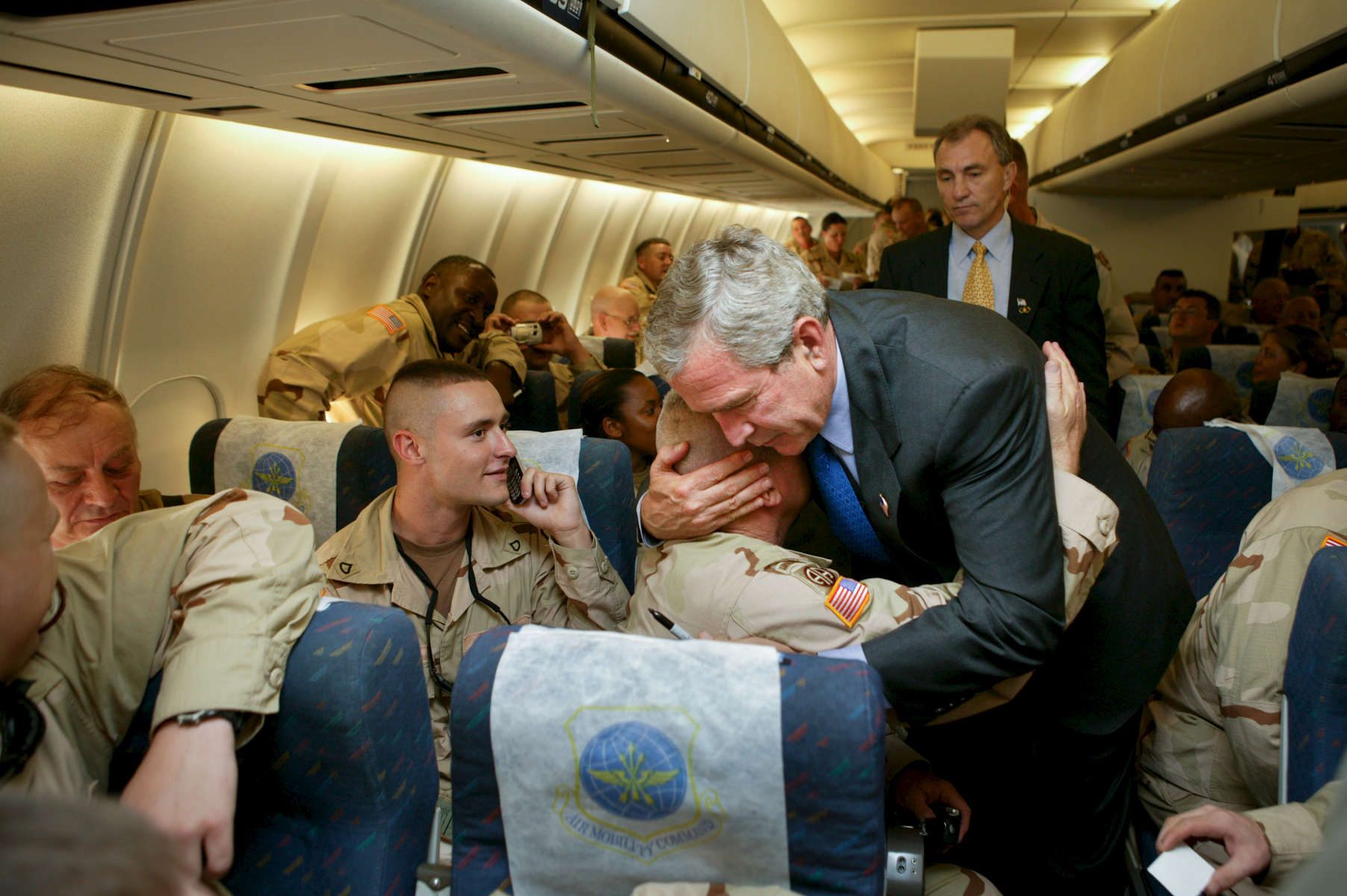 Digital: GWB 17:10 OTR at Bangor International Airport, Bangor, Maine. President Bush visits elements of the  30th National Guard Brigade Combat Team, 230th National Guard Area Support Group, and 414th Army Transport Batallion on their way to Iraq during a refueling stop.