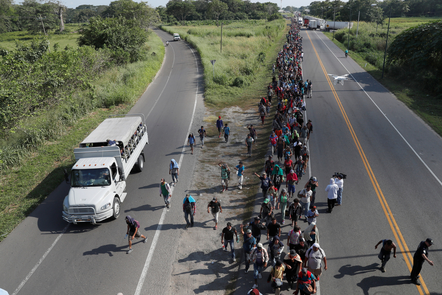 Central American migrants walk along the highway near of Ciudad Hidalgo after crossing to Mexico from Guatemala with the hope of reaching the U.S. eventually.
