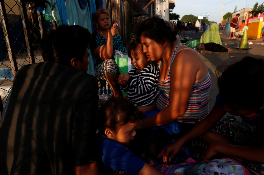 Migrant Cara Martinez, part of a caravan traveling to the U.S., holds her daughter Dania Martinez, 1, at the border crossing after they were stopped there the day before in Ciudad Tecun Uman, Guatemala.