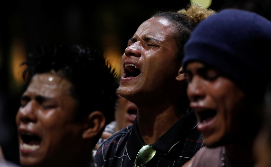 Jose Antonio Perdomo Zuniga of Honduras, sings and prays with other migrants from a caravan he is part of who are traveling to the U.S. while they rest in the Central Park of Miguel Hidalgo in Tapachula, Mexico.