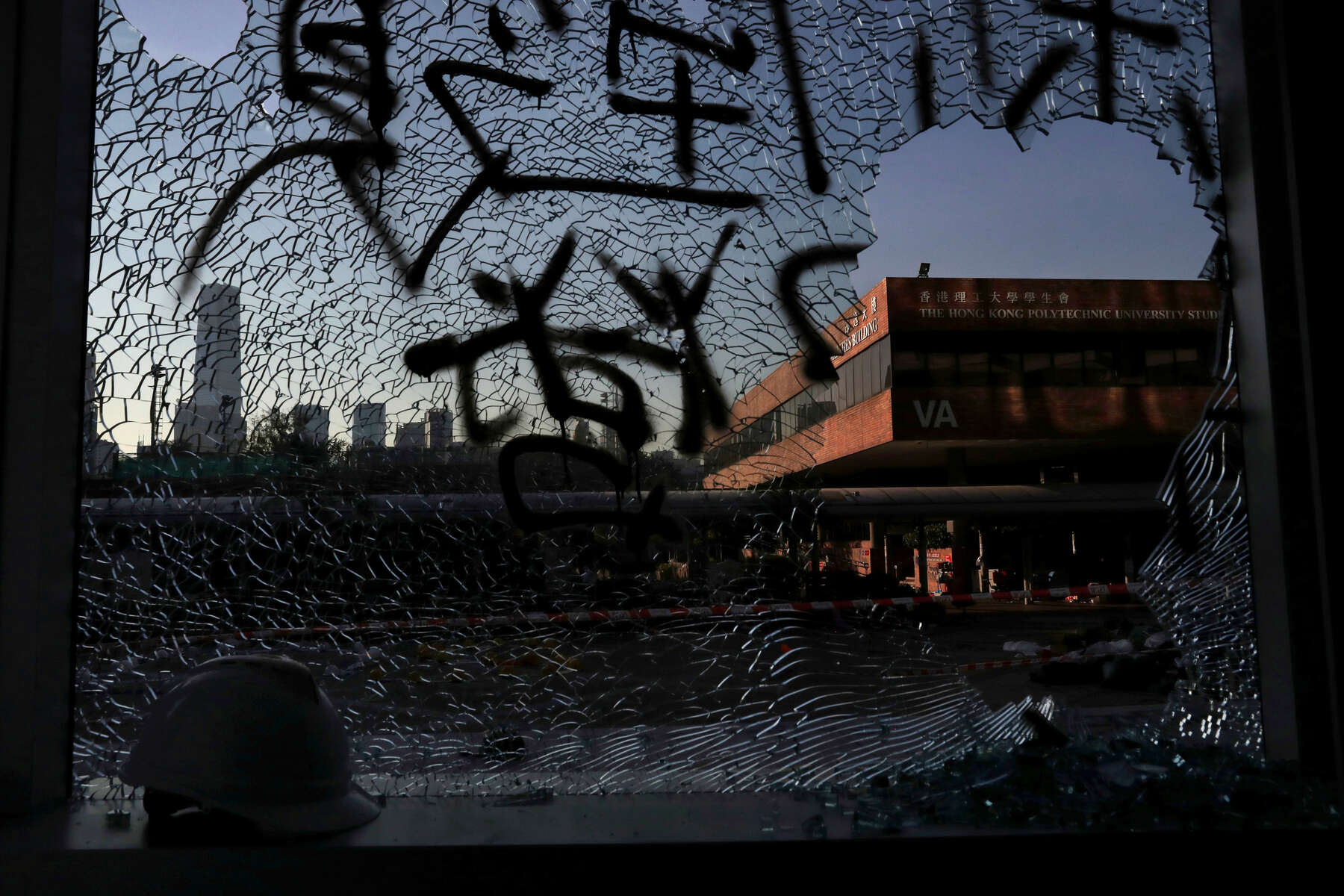 Shattered glass is seen at Hong Kong Polytechnic University (PolyU), in Hong Kong, China November 22, 2019. The wrecked campus went from a battle ground to a ghost town with rumors of handfuls of protesters hidden throughout the vast space. Surrendering to police came with a charge of {quote}rioting{quote} which can come with up to 10 years in prison. Many protesters were arrested in the first few hectic days, others escaped via increasingly dramatic ways, including through the sewer system.