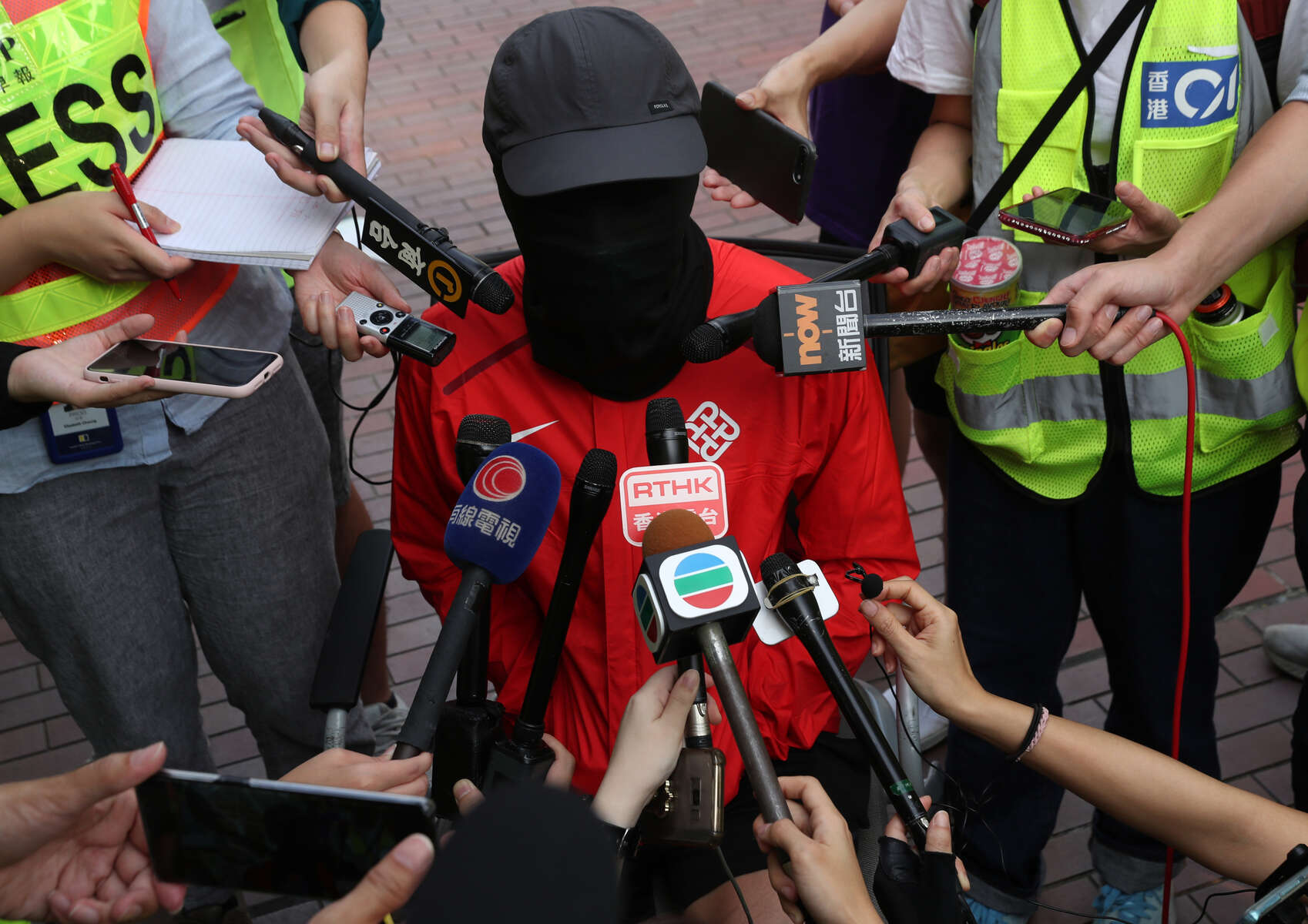 Members of the news media interview a remaining protester who is trapped inside of the Hong Kong Polytechnic University (PolyU) in Hong Kong, China, November 23, 2019.