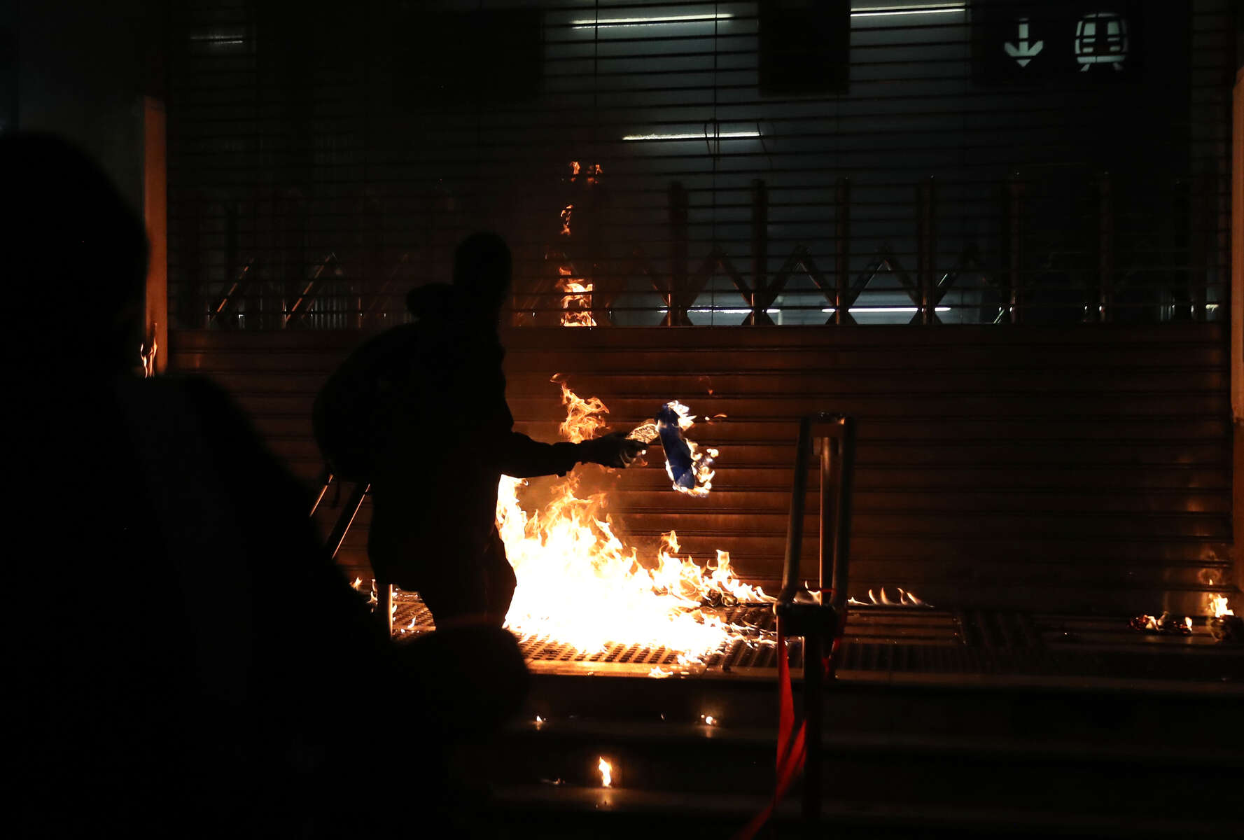 A protester throws a Molotov cocktail at an MTR station in Hung Hom after a day of protests in Hong Kong, China December 1, 2019.