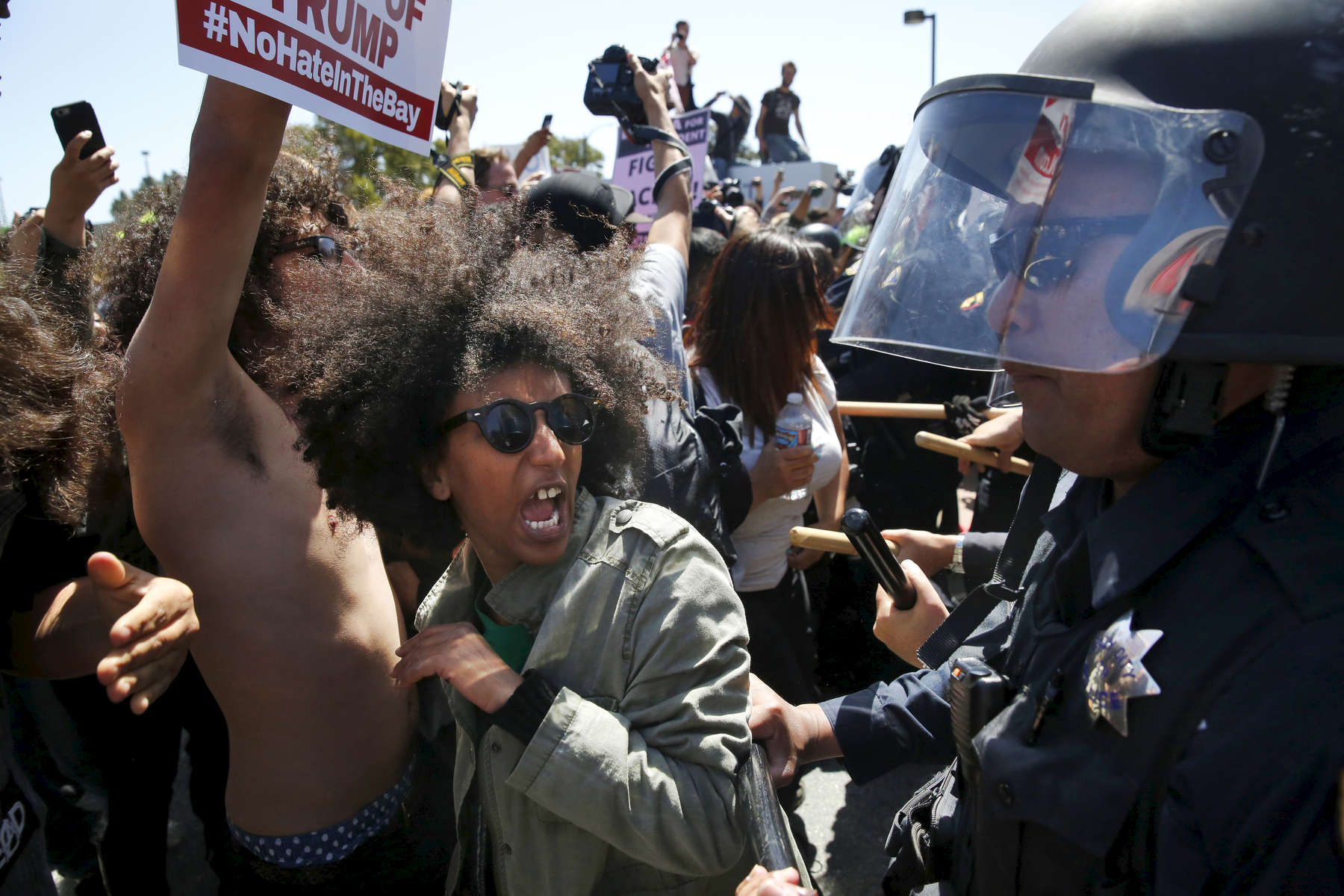 Biseat Yawkal, an Oakland protester, yells as she is pushed by police trying to push protesters back outside of the Hyatt Regency during the first day of the California Republican Party Convention in Burlingame, Calif., Thursday, April 29, 2016. The convention featured speeches from Presidential candidates Donald Trump and John Kasich among others. (Leah Millis/San Francisco Chronicle via AP) MANDATORY CREDIT