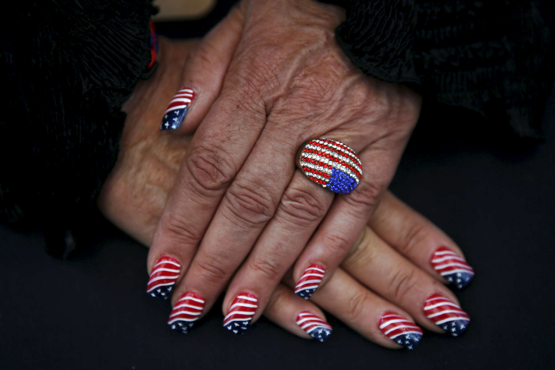 Elizabeth Ritchie with the California Federation of Republican Women shows off her custom nail job for a photograph during the second day of the California Republican Party Convention which featured a speech from Presidential candidate Ted Cruz April 30, 2016 at the Hyatt Regency in Burlingame, Calif.
